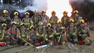 Firefighters Pose for Picture in Front of Fire